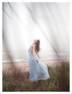 Rasa Zukauskaite, photographed by Paul de Luna for the latest issue of WestEast Magazine. #rasa_zukauskaite #paul_de_luna #westeast #photography #women #clothing #sensual #blue #white #grey #grass #outdoors #dresses