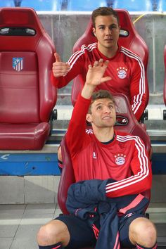 Thomas Mueller Photos Photos - Thomas Mueller of Muenchen (front) sits on the bench with team mate Mario Goetze prior to the UEFA Champions League semi final first leg match between Club Atletico de Madrid and FC Bayern Muenchen at Vincente Calderon on April 27, 2016 in Madrid, Spain - Club Atletico de Madrid v FC Bayern Muenchen - UEFA Champions League Semi Final: First Leg