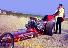Beautiful candy red Don Prudhomme front engined dragster with nitro Hemi power, early sixties.