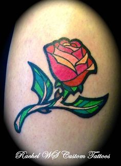 """Stained Glass Rose from Beauty and the Beast! I'd get that Latin quote under it, the one in Beasts' window. It translates in English to,""""He conquers who conquers himself""""."""