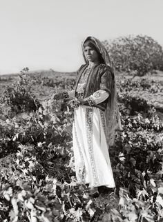 girl holding a bunch of grapes. Ein Yabrud, Palestine. 1937 September.