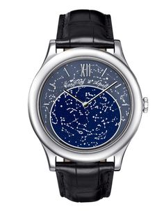 Van Cleef & Arpels   Van Cleef & Arpels  Van Cleef & Arpels' Midnight in Paris watch in white gold with aventurine glass and meteorite design dial. Features season calendar, mechanical caliber and an alligator bracelet.
