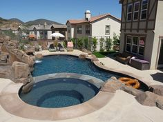 Free form pool spa w travertine pavers flagstone beach entry built in fire pit a real rock for Swimming pool contractors san francisco bay area