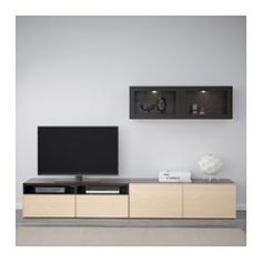 IKEA - BESTÅ, TV storage combination/glass doors, black-brown Valviken/dark blue clear glass, drawer runner, soft-closing, , The drawers and doors have integrated push-openers, so you don't need handles or knobs and can open them with just a light push.This TV storage combination has plenty of extra storage and makes it easy to keep your living room organised.It's easy to keep the cables from your TV and other devices out of sight but close at hand, as there are several cable outlet...