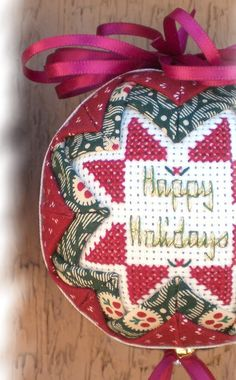 One of my favorites from the second book - love using the shiny, metalic floss! Folded Fabric Ornaments, Quilted Christmas Ornaments, Christmas Cover, Christmas Balls, Globe Ornament, Star Ornament, Ball Ornaments, Counted Cross Stitch Patterns, Cross Stitch Embroidery