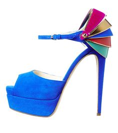 Brian Atwood. I LOVE Atwood heels. With this one the sort of layered multi-colored heel is incredible!!!