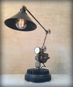 Keeping it Cool © Found object sculpture by award winning artist Jay Lana #steampunklighting #repurpose #industriallighting #foundobject