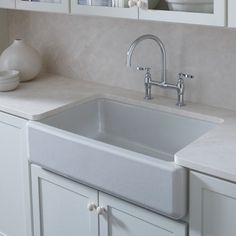 We love this deep, single-basin farmhouse-style kitchen sink. Go ahead and let the dishes pile up.