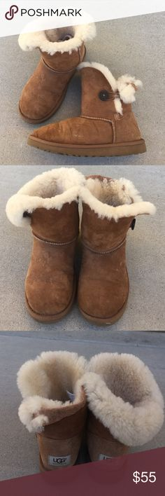 UGGS short tan boots Size 5 , gently worn , clean over all , left boot back top portion is missing some of the fur , as shown in the pictures , does not impede use of boot UGG Shoes