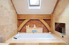 The bathroom is complete with a spacious bath tub - illuminated with a sky light directly above.