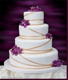 cakes effortless elegance this wedding cake is decorated with purple ... #purpleweddingcakes
