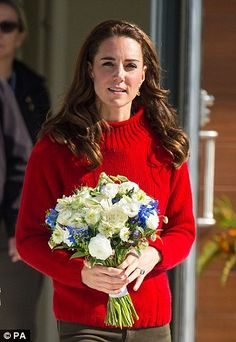 Kate looked cosy in a soft red cashmere jumper from Really Wild Clothing
