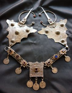 A set of large triangular linked fibulae with glass and enamelling