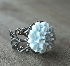 Etsy favorite. Everyone should own #lizhutnick flower rings, in many colors!