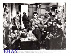 George Hamilton, Vince Edwards, George Peppard, and James Mitchum, in a scene from The Victors (1963). James is seen at the far right.