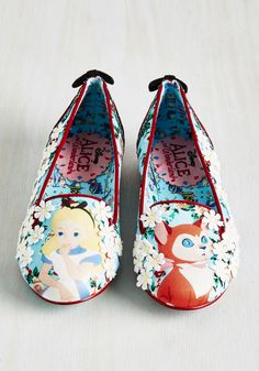 Flaunt your inquisitive nature with this pretty pair of glittery flats. A limited edition design by Irregular Choice, these loafers delight with darling daisy appliques, velvety bows at the heels, and a duo of characters that are certain to peak interest with each adventurous step you take!