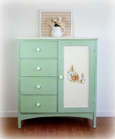 Child's chifferobe with a Peter Rabbit theme. Custom mix Antibes Green, Anoinette Pink and Old White (Annie Sloan Chalk Paint) to create a vintage color.