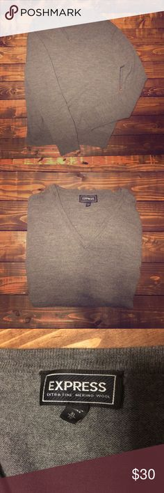 XL Mens Express Gray Super Soft Wool Sweater This gray mens Express sweater is super soft! It's made with 100% merino wool. It's a size XL and was only worn a handful of times so in great condition. Express Sweaters V-Neck