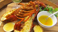 Wood-grilled lobster with tomalley butter and grilled lemon | Using wood from grape vines, Adam Liaw grills his lobster on an outdoor wood-fire grill.In this recipe, he makes a butter to complement the seafood using the tomalley from the inside of the lobster with a beautiful, rich seafood flavour.