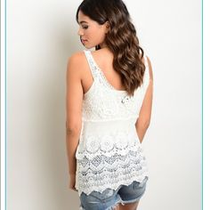 IN STOCK cream white crochet tank Beautiful white tank featuring a crocheted design! I have 2 s/m available and 2 m/l available!  this is a perfect beach cover up or beautiful with a bandeau underneath! Swim Coverups