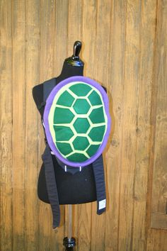 READY TO SHIP  Purple- Rimmed Turtle Shell Bjorn Baby Carrier Cover With Huge Storage Pocket   Naturallycraftyshop on Etsy.  Best baby shower gift ever!