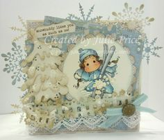 In The Snow Ski Tilda from the Winter Wonderland collection and the Lovely Fence and Christmas tree kit doohickey dies,Full details on my blog http://julieprice3.wordpress.com