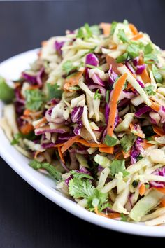 Ginger Asian coleslaw is packed with fresh flavors like ginger, peanut butter & cilantro! It's delicious as a side dish or to top sandwiches and wraps! Vegan Keto Diet, Vegan Keto Recipes, Cooking Recipes, Healthy Recipes, Meatless Recipes, Vegetarian Keto, Vegan Foods, Vegan Meals, Raw Vegan