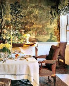 On the dining room wall hangs an 1820's scenic French wallpaper--carefully restored; Eau de nil silk taffeta blinds in the window; a good quality linen tablecloth; a comfortable 18th century chair in striped velvet - Et voilà. Text from John Stefanidis Blogspot August 2012 #johnstefanidis #design #interiordesign #dining #inspirational #beauty #timeless
