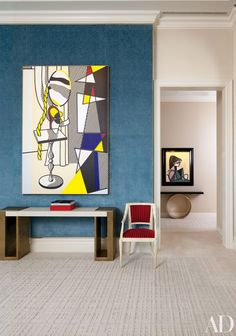 In the living room of Steve Wynn and wife Andrea's Manhattan duplex, a 1977 Roy Lichtenstein canvas hangs above an Hervé Van der Straeten console from Ralph Pucci International; a 1958 Picasso painting is displayed in the hall.