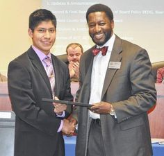 Esdras Gutierrez accepts his award from J.R. Green, superintendent of Fairfield County Schools.