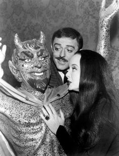 The Addams Family John Astin (Gomez) and Carolyn Jones (Morticia) pose with a Devil statue in this 1965 publicity photo.
