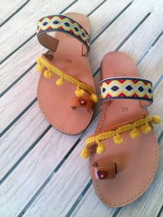 a38ca431119 Handmade item Leather greek sandals. Decorated with yellow pom  pom