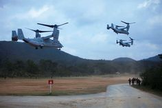 Three U.S. Marine MV-22 Ospreys with Marine Medium Tiltrotor Squadron 262 take off from a landing zone after dropping off Marines with Company E, Battalion Landing Team, 2nd Battalion 4th Marines, 31st Marine Expeditionary Unit (MEU), during a vertical assault while conducting the MEU Exercise (MEUEX), in Combat Town, Okinawa, Japan, Dec 10, 2014. BLT 2/4 is conducting training in preparation of their upcoming spring patrol. (U.S. Marine Corps photo by GySgt Ismael Pena/Released)