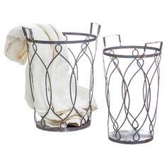 Showcasing an open lattice design, these weathered metal nesting baskets are perfect for holding utensils in the kitchen or bath linens in your master suite....