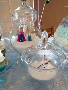 Decorations in glass jars at a Frozen girl Birthday Party! See more party ideas at CatchMyParty.com!