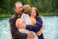 The big reveal - seeing the bride in her wedding dress for the first time. We loved capturing this mountain wedding photography up in Barriere, British Columbia Canada!  http://tailoredfitphotography.com/wedding-photography/kamloops-barriere-wedding-johnson-lake-resort/