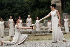 Actress Ino Menegaki (right), in the role of the High Priestess, lights the torch of the Olympic Flame during the Lighting Ceremony in front of the Hera Temple in Ancient Olympia. British Olympic chiefs including Lord Coe looked on in Greece today as the countdown to London 2012 began. The traditional ceremony took place under baking sun and tight security in front of the ruins of the Temple of Hera in Greece, birthplace of the Ancient Games. via dailymail.co.uk