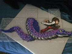 Oracion Seis member Cobra and his snake Cubellios - Fairy Tail perler beads by TehMorrison Perler Beads, Perler Bead Art, Fairy Tail Photos, Fairy Tail Art, Cute Crafts, Bead Crafts, Anime Pixel Art, Beaded Cross Stitch, Anime Fairy