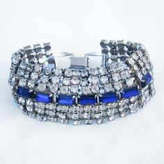 This is just stunning and may just end up in my cart. Vintage Crystal and Sapphire Rhinestone Cuff Bracelet by DawnaS, $44.00