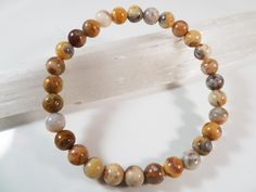 Crazy Lace Agate Stretch Bracelet 6mm Smooth Round Gemstone Beads by SandiLaneFineArt on Etsy