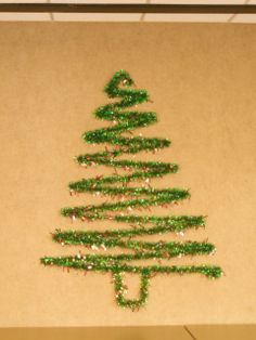 I took garland, thumb tacks, and a ruler and made a very cute Wall Christmas Tree!