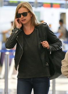 Emily VanCamp is biker chic as she arrives to catch a flight at LAX