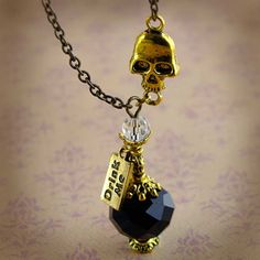 Draught of Living Death Potion Necklace Harry Potter Antique Gold Black Crystal. $12.50, via Etsy.