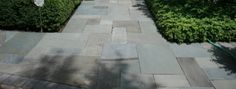 A quality natural stone cleaning and power washing company like Paver Protector can restore the original beauty of flagstone and bluestone patios and walkways without damaging the surface. | www.paverprotector.com #paverprotector