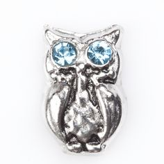 Silver Owl with Blue Rhinestone eyes.  What a cute floating charm, for a living locket, or memory bracelet of any size.