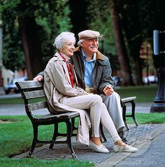 Older Couple Sitting on Park Bench Together | Stock Photo #1525R-41451
