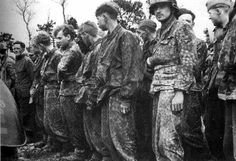 Waffen SS troops taken prisoner during the early fighting after the invasion of Normandy, June 1944.