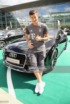 Robert Lewandowski of FC Bayern poses with his new Audi car during the official…
