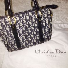 "Christian Dior ""Trotter"" Boston Handbag 100% Authentic. Beautiful Christian Dior in excellent condition. This is about the size of a Louis Vuitton Speedy 25. It is a navy CD canvas pattern with Gold emblems and zippers! Comes with lock and dustbag. Dior Bags Totes"