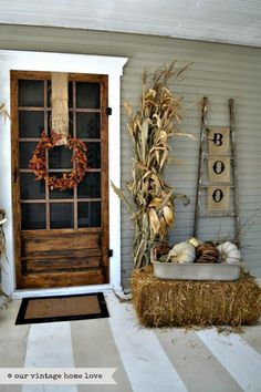 our vintage home love: Fall Porch Ideas My favorites are the ladder and burlap holding the wreath and there are corn stalks too!